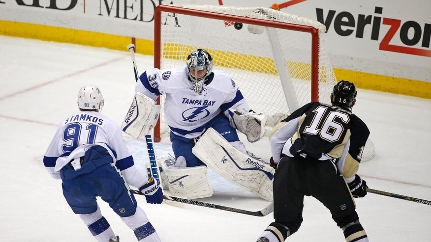 Pittsburgh Penguins' Brandon Sutter (16) lifts a shot over Tampa Bay Lightning goalie Ben Bishop (30) for a goal during the first period of an NHL hockey game against the Tampa Bay Lightning  in Pittsburgh Monday, Dec. 15, 2014.(AP Photo/Gene J. Puskar)