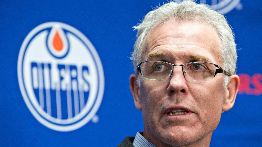 Edmonton Oilers General Manager Craig MacTavish speaks about the firing of head coach Dallas Eakins in Edmonton, Alberta, Monday Dec. 15, 2014. (AP Photo/The Canadian Press, Jason Franson)