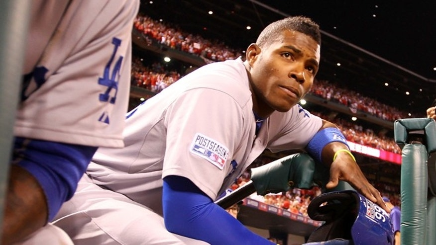 ST LOUIS, MO - OCTOBER 07:  Yasiel Puig #66 of the Los Angeles Dodgers looks on from the dugout steps after being defeated by the St. Louis Cardinals in Game Four of the National League Divison Series at Busch Stadium on October 7, 2014 in St Louis, Missouri.  (Photo by Jamie Squire/Getty Images)