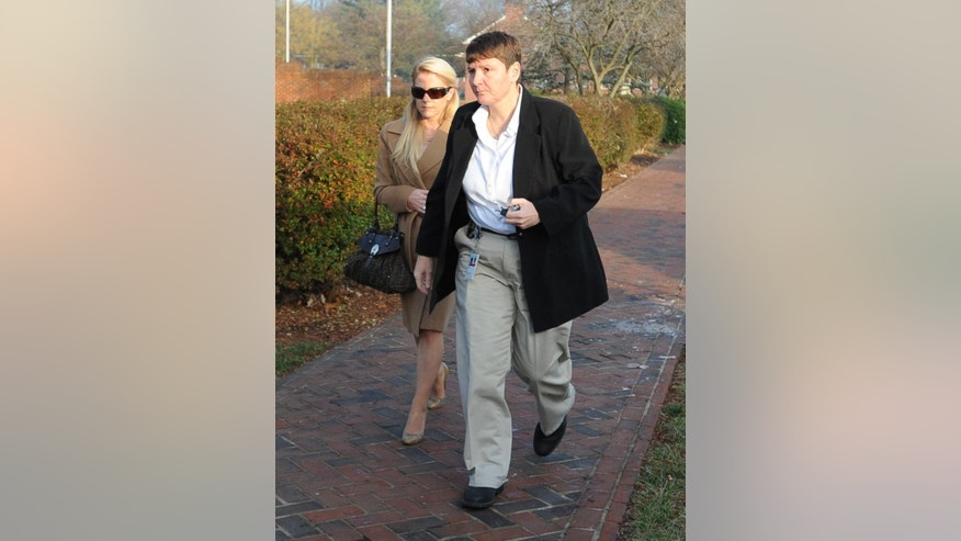 Patricia Driscoll left, the former girlfriend of NASCAR driver Kurt Busch, arrives at Family Court, Tuesday, Dec. 16, 2014, in Dover, Del., for a hearing related to a protective order she filed against him.  (AP Photo/The Wilmington News-Journal, Jason Minto)  NO SALES