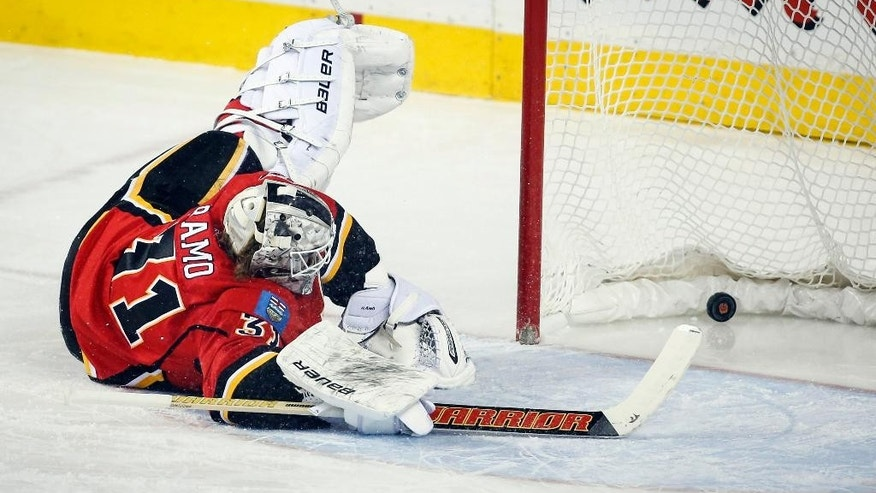 Calgary Flames goalie Karri Ramo, from Finland, lets in a goal during the first period of an NHL hockey game against the New York Rangers in Calgary, Alberta, Tuesday, Dec. 16, 2014. (AP Photo/The Canadian Press, Jeff McIntosh)