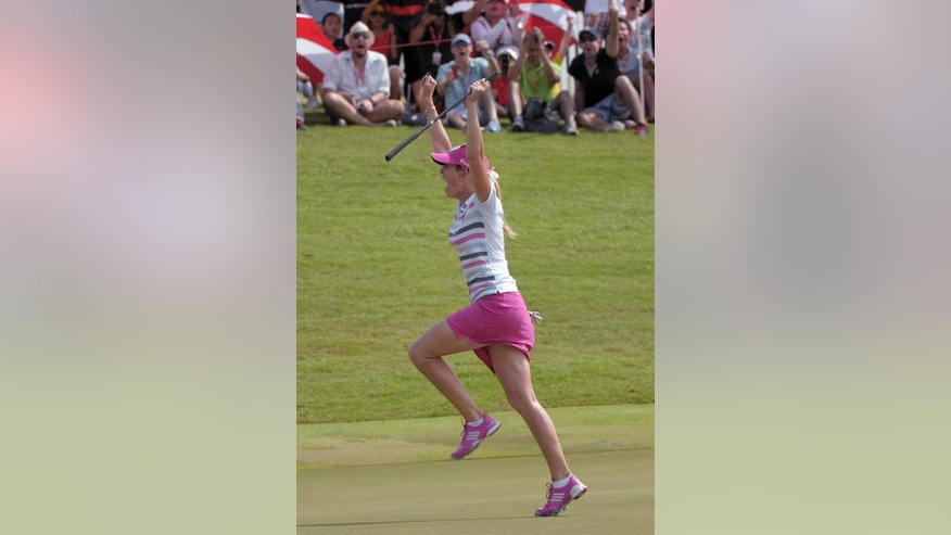 FILE - In this March 2, 2014, file photo, Paula Creamer of the UNited States celebrates after winning the HSBC Women's Champions golf tournament in Singapore. Creamer made a 75-foot eagle putt to win. (AP Photo/Joseph Nair, File)