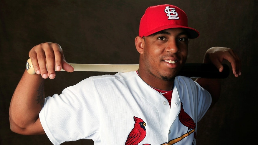 JUPITER, FL - FEBRUARY 24:  Oscar Taveras #77 of the St. Louis Cardinals poses for a portrait during photo day at Roger Dean Stadium on February 24, 2014 in Jupiter, Florida.  (Photo by Rob Carr/Getty Images)