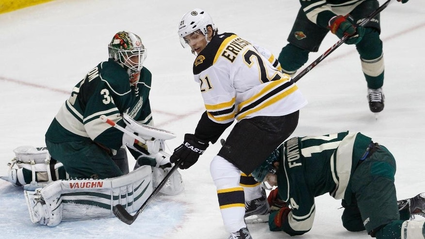 Boston Bruins left wing Loui Eriksson (21), of Sweden, and Minnesota Wild right wing Justin Fontaine, right, chase a rebound in front of  Wild goalie Niklas Backstrom, left, of Finland, during the first period of an NHL hockey game in St. Paul, Minn., Wednesday, Dec. 17, 2014. (AP Photo/Ann Heisenfelt)