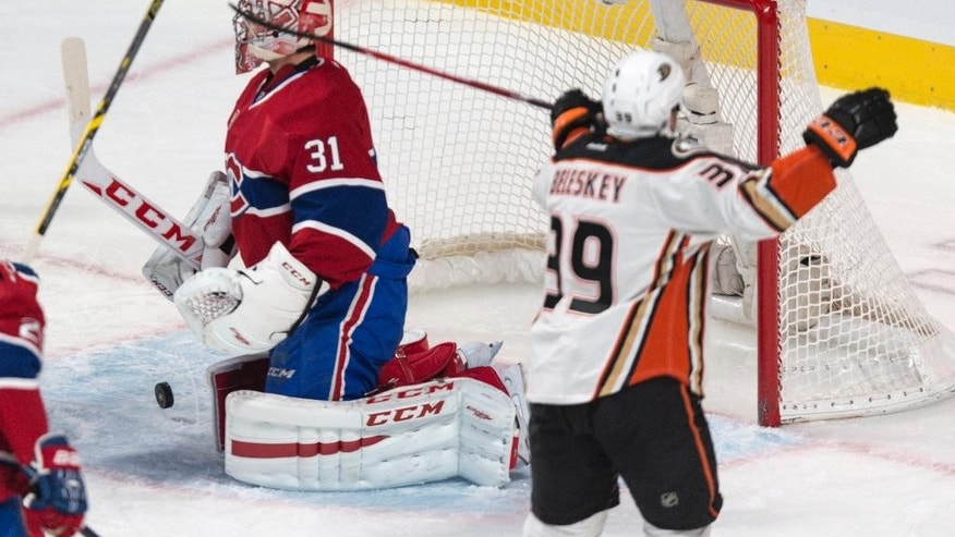 Anaheim Ducks' Matt Beleskey celebrates his goal past Montreal Canadiens goalie Carey Price during the third period of an NHL hockey game, Thursday, Dec. 18, 2014, in Montreal. (AP Photo/The Canadian Press, Paul Chiasson)