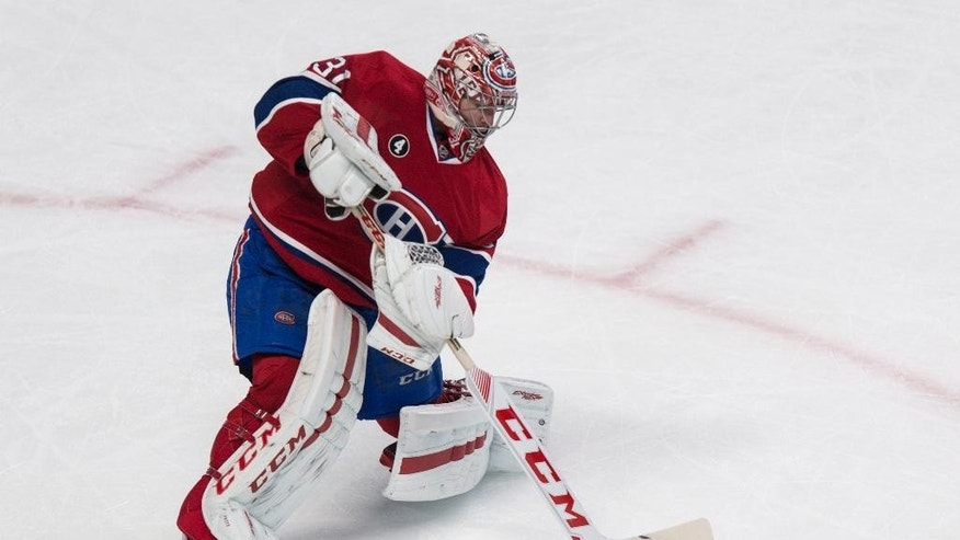 Montreal Canadiens goalie Carey Price clears the puck as they face the Anaheim Ducks during the second period of an NHL hockey game, Thursday, Dec. 18, 2014, in Montreal. (AP Photo/The Canadian Press, Paul Chiasson)