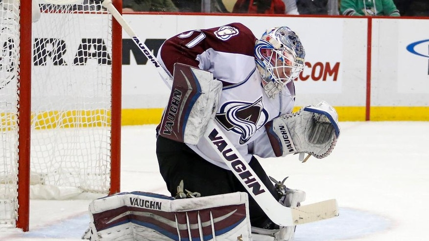 Colorado Avalanche goalie Calvin Pickard blocks a Pittsburgh Penguins shot during the second period of an NHL hockey game Thursday, Dec. 18, 2014, in Pittsburgh. (AP Photo/Gene J. Puskar)
