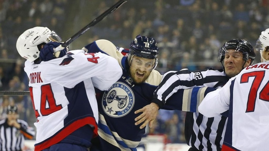 Columbus Blue Jackets' Nick Foligno (71) and Washington Capitals' Brooks Orpik (44) collide during the second period of an NHL hockey game, Thursday, Dec. 18, 2014, in Columbus, Ohio. (AP Photo/Mike Munden)
