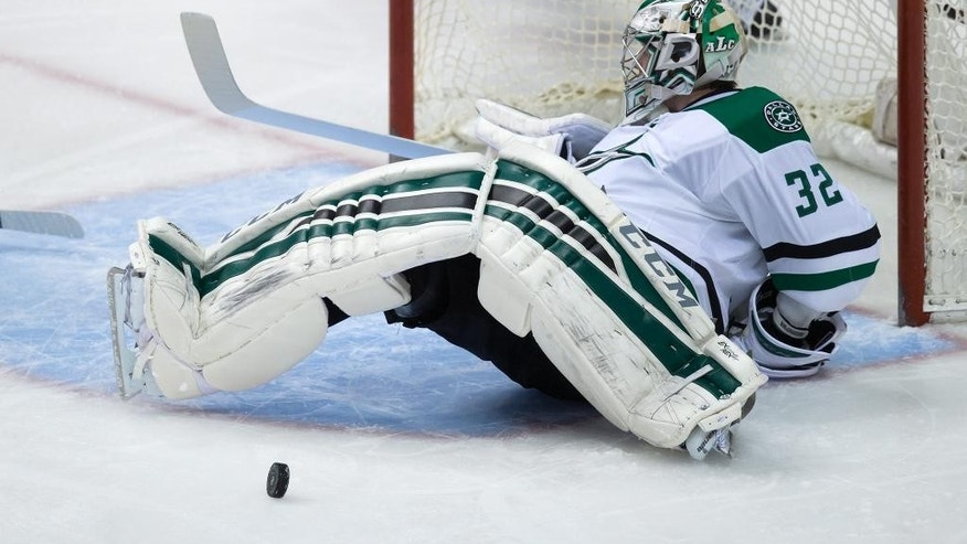 Dallas Stars goalie Kari Lehtonen, of Finland, stops a Vancouver Canucks shot during the second period of an NHL hockey game Wednesday, Dec. 17, 2014, in Vancouver, British Columbia. (AP Photo/The Canadian Press, Darryl Dyck)