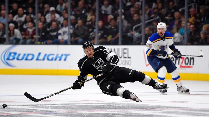 Los Angeles Kings center Trevor Lewis, left, falls as St. Louis Blues defenseman Chris Butler looks on during the first period of an NHL hockey game, Thursday, Dec. 18, 2014, in Los Angeles. (AP Photo/Mark J. Terrill)