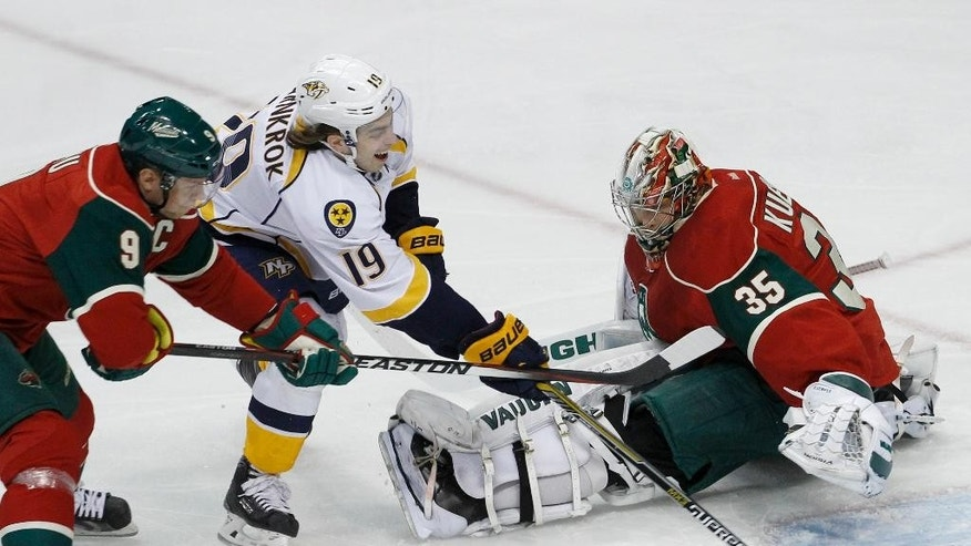 Nashville Predators center Calle Jarnkrok (19), of Sweden, scores on Minnesota Wild goalie Darcy Kuemper (35) as Wild center Mikko Koivu (9), of Finland, tries unsuccessfully to stop him during the first period of an NHL hockey game in St. Paul, Minn., Saturday, Dec. 20, 2014. (AP Photo/Ann Heisenfelt)
