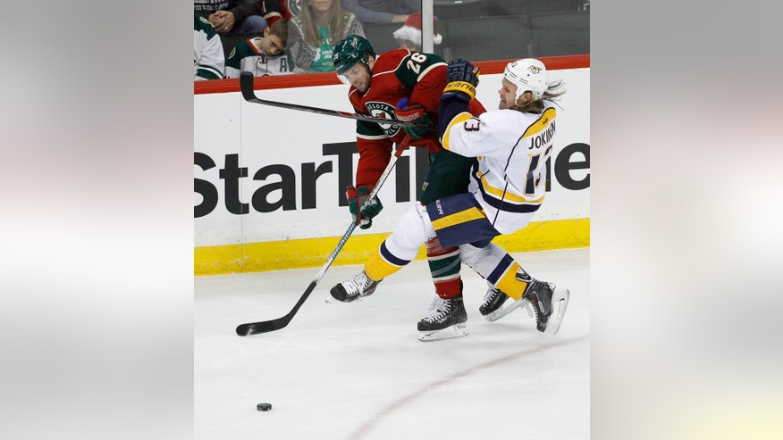 Minnesota Wild left wing Thomas Vanek (26), of Austria, checks Nashville Predators center Olli Jokinen (13), of Finland, off the puck during the first period of an NHL hockey game in St. Paul, Minn., Saturday, Dec. 20, 2014. (AP Photo/Ann Heisenfelt)
