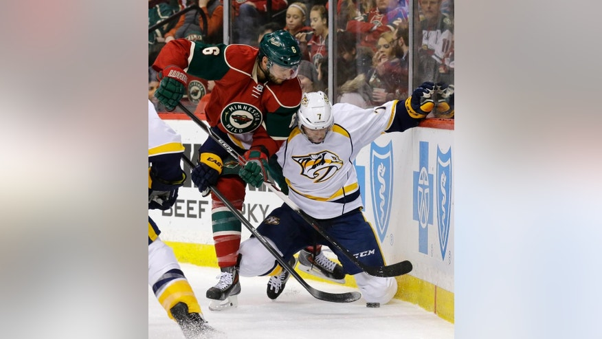 Nashville Predators center Matt Cullen (7) and Minnesota Wild defenseman Marco Scandella (6) battle for the puck during the second period of an NHL hockey game in St. Paul, Minn., Saturday, Dec. 20, 2014. (AP Photo/Ann Heisenfelt)