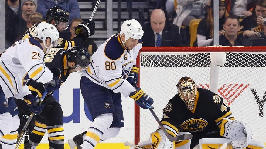 Buffalo Sabres' Chris Stewart (80) looks for the rebound on the shot blocked by Boston Bruins' Tuukka Rask (40), of Finland, in the second period of an NHL hockey game in Boston, Sunday, Dec. 21, 2014. The Bruins won 4-3 in overtime. (AP Photo/Michael Dwyer)