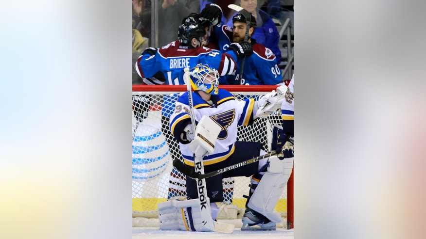 St. Louis Blues goalie Jake Allen (34) reacts to a goal by Colorado Avalanche center Ryan O'Reilly (90), who celebrates with teammates Gabriel Landeskog (92) and Tyson Barrie (4) during the second period of an NHL hockey game Tuesday, Dec. 23, 2014, in Denver. (AP Photo/Jack Dempsey)