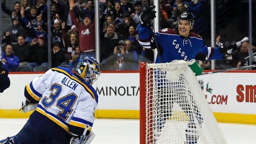 Colorado Avalanche defenseman Zach Redmond (22) celebrates a goal on St. Louis Blues goalie Jake Allen (34) during the first period of an NHL hockey game Tuesday, Dec. 23, 2014, in Denver. (AP Photo/Jack Dempsey)