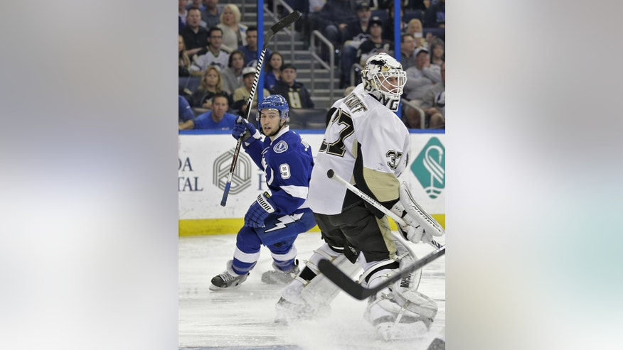 Tampa Bay Lightning center Tyler Johnson (9) celebrates after scoring past Pittsburgh Penguins goalie Jeff Zatkoff (37) during the second period of an NHL hockey game Tuesday, Dec. 23, 2014, in Tampa, Fla. (AP Photo/Chris O'Meara)