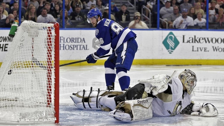 Tampa Bay Lightning right wing Nikita Kucherov (86), of Russia, scores past Pittsburgh Penguins goalie Marc-Andre Fleury (29) during the second period of an NHL hockey game Tuesday, Dec. 23, 2014, in Tampa, Fla. (AP Photo/Chris O'Meara)