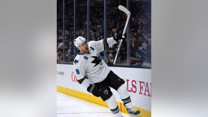 San Jose Sharks center Joe Pavelski celebrates his goal during the first period of an NHL hockey game against the Los Angeles Kings, Saturday, Dec. 27, 2014, in Los Angeles. (AP Photo/Mark J. Terrill)