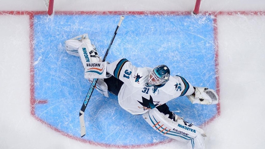 San Jose Sharks goalie Antti Niemi, of Finland, is scored on by Los Angeles Kings center Tyler Toffoli during the first period of an NHL hockey game, Saturday, Dec. 27, 2014, in Los Angeles. (AP Photo/Mark J. Terrill)