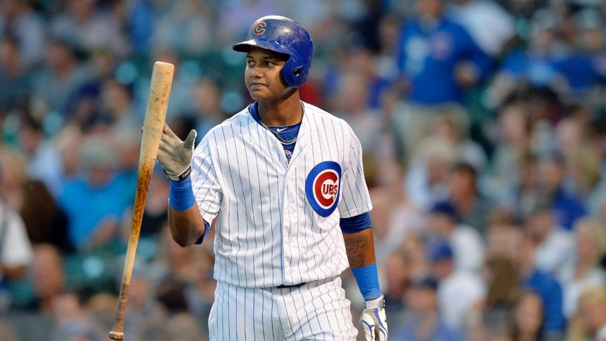 CHICAGO, IL- JULY 29:  Starlin Castro #13 of the Chicago Cubs flips his bat after popping up with runners in scoring position during the first inning against the Colorado Rockies on July 29, 2014 at Wrigley Field in Chicago, Illinois.  (Photo by Brian Kersey/Getty Images)