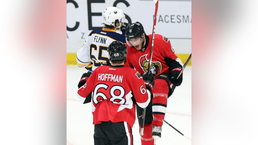 Ottawa Senators' Bobby Ryan (6) celebrates his second goal of the game against the Buffalo Sabres with teammate Mike Hoffman (68) during the second period of an NHL hockey game in Ottawa, Ontario, Monday, Dec. 29, 2014. (AP Photo/The Canadian Press, Fred Chartrand)