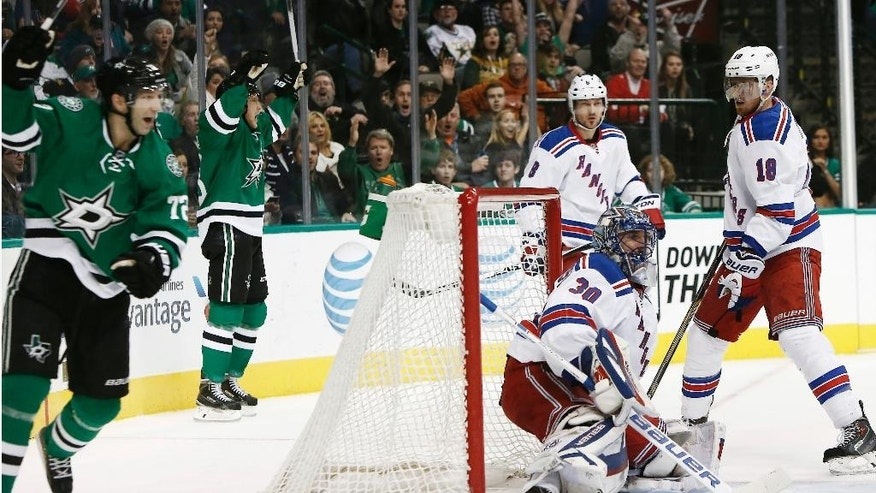 Dallas Stars forwards Ales Hemsky, back left, and Erik Cole, front left, celebrate Hemsky's centering pass ricocheting off of New York Rangers defenseman Marc Staal (18) and past goalie Henrik Lundqvist (30) for a goal during the first period of an NHL hockey game, Monday, Dec. 29, 2014, in Dallas, Texas. (AP Photo/Brandon Wade)
