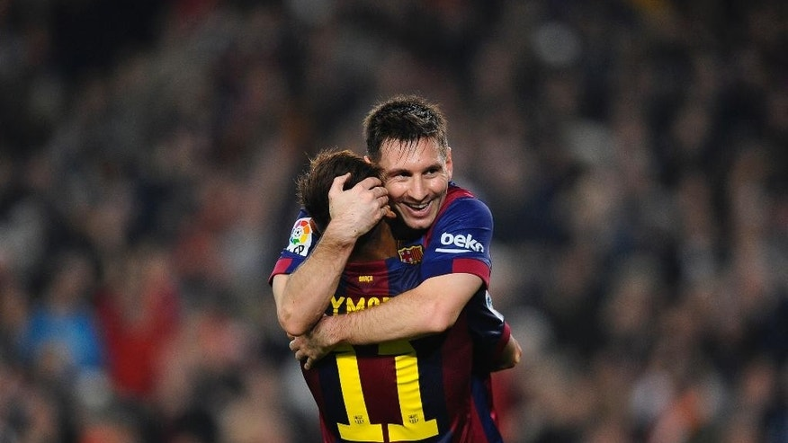FILE - In this Nov. 22, 2014, file photo, FC Barcelona's Lionel Messi, from Argentina, right, celebrates with his teammate Neymar, from Brazil, after scoring against Sevilla during a Spanish La Liga soccer match between FC Barcelona and Sevilla,  at the Camp Nou stadium in Barcelona, Spain.  Messi set a La Liga scoring record of 253 goals when he claimed a hat-trick in Saturday's match at the Camp Nou stadium against Sevilla. (AP Photo/Manu Fernandez, File)