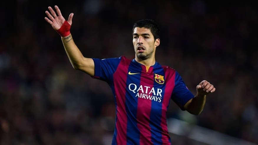 BARCELONA, SPAIN - DECEMBER 10:  Luis Suarez of FC Barcelona reacts during the UEFA Champions League group F match between FC Barcelona and Paris Saint-Germanin FC at Camp Nou Stadium on December 10, 2014 in Barcelona, Spain.  (Photo by David Ramos/Getty Images)