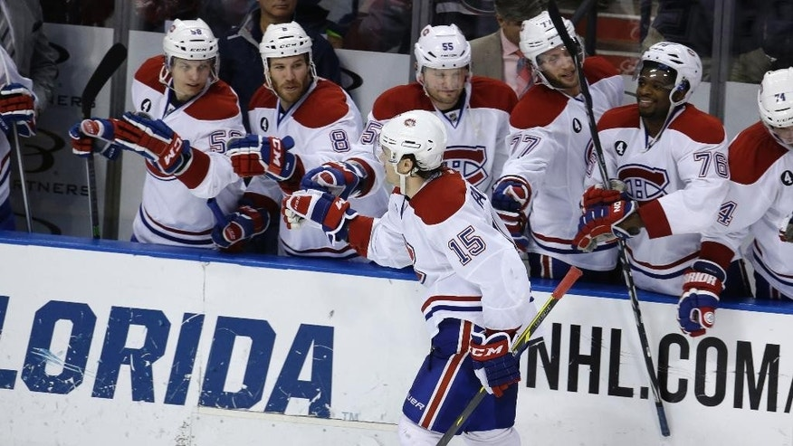 Montreal Canadiens right wing P.A. Parenteau (15) is congratulated by his teammates after scoring during the shootout in an NHL hockey game against the Florida Panthers, Tuesday, Dec. 30, 2014, in Sunrise, Fla. The Canadiens won 2-1. (AP Photo/Lynne Sladky)
