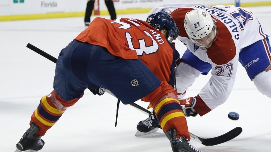 Florida Panthers center Dave Bolland (63) and Montreal Canadiens center Alex Galchenyuk (27) go for the puck in a face-off during the first period of an NHL hockey game, Tuesday, Dec. 30, 2014, in Sunrise, Fla. (AP Photo/Lynne Sladky)