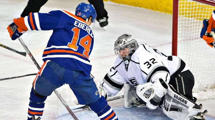 Los Angeles Kings goalie Jonathan Quick (32) makes the save on Edmonton Oilers' Jordan Eberle (14) during the second period of an NHL hockey game Tuesday, Dec. 30, 2014, in Edmonton, Alberta. (AP Photo/The Canadian Press, Jason Franson)