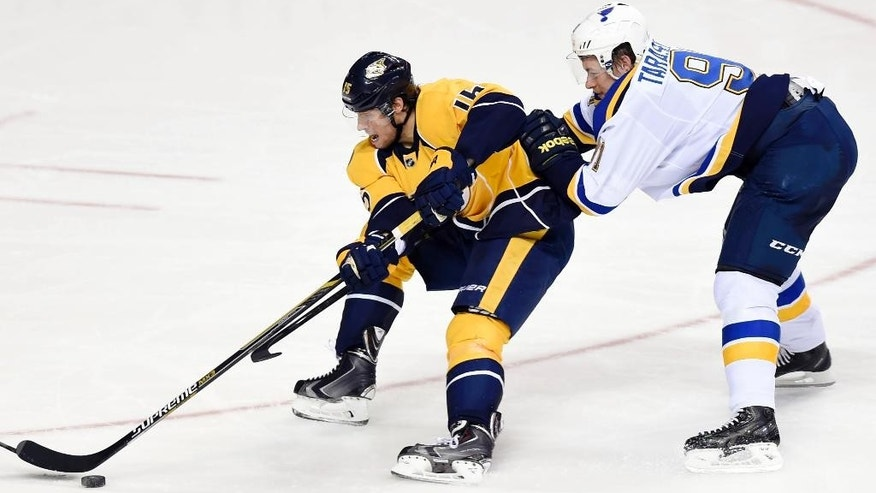 Nashville Predators center Craig Smith (15) battles St. Louis Blues right wing Vladimir Tarasenko (91), of Russia, in the second period of an NHL hockey game Tuesday, Dec. 30, 2014, in Nashville, Tenn. (AP Photo/Sanford Myers)