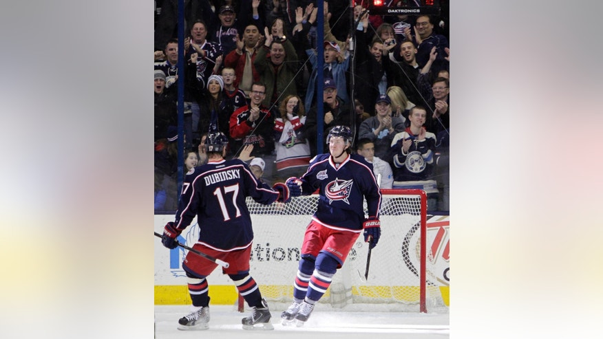 Columbus Blue Jackets' Ryan Johansen, right, celebrates his goal against the Minnesota Wild with Brandon Dubinsky during the third period of an NHL hockey game Wednesday, Dec. 31, 2014, in Columbus, Ohio. The Blue Jackets won 3-1. (AP Photo/Jay LaPrete)
