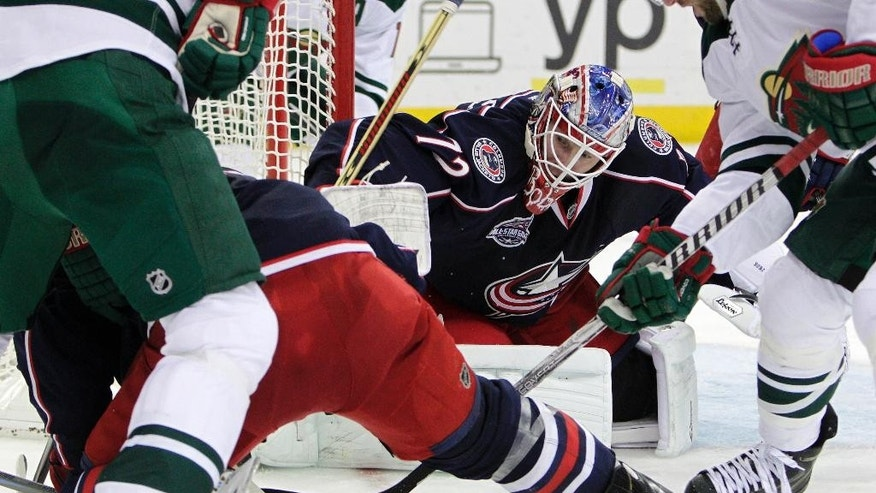 Columbus Blue Jackets' Sergei Bobrovsky, of Russia, makes a save against the Minnesota Wild during the third period of an NHL hockey game Wednesday, Dec. 31, 2014, in Columbus, Ohio. The Blue Jackets won 3-1. (AP Photo/Jay LaPrete)