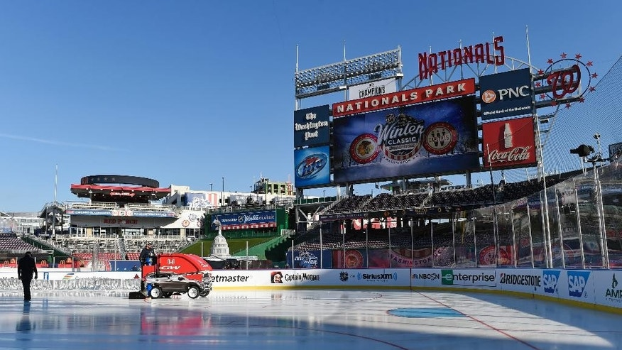 Final preparations are made at Nationals Park, Wednesday, Dec. 31, 2014, for the Winter Classic outdoor NHL hockey game to be held on New Year's Day. The Washington Capitals are scheduled to play the Chicago Blackhawks. (AP Photo/Susan Walsh)