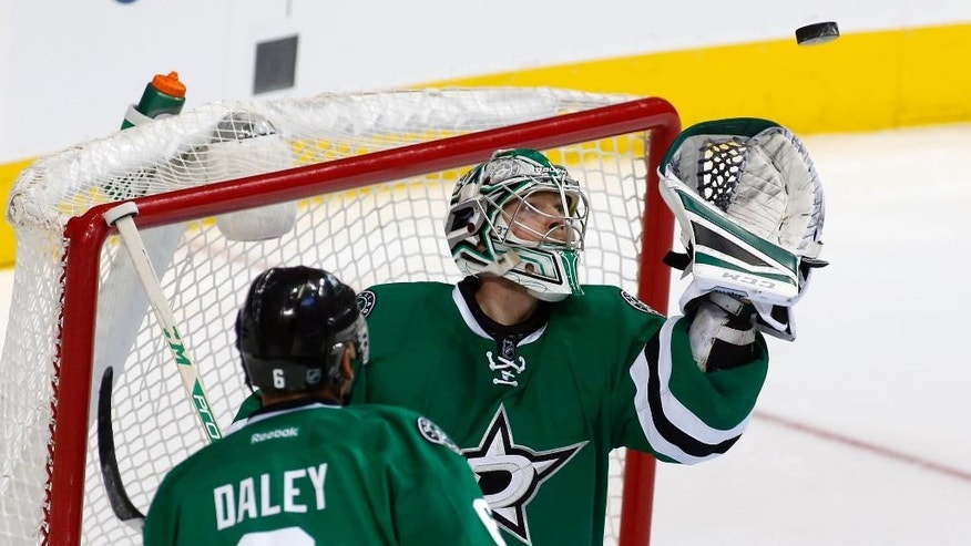 Dallas Stars' defenseman Trevor Daley (6) watches as goalie Kari Lehtonen, of FInland, makes a save in the second period of an NHL hockey game against the Arizona Coyotes, Wednesday, Dec. 31, 2014, in Dallas. (AP Photo/Sharon Ellman)