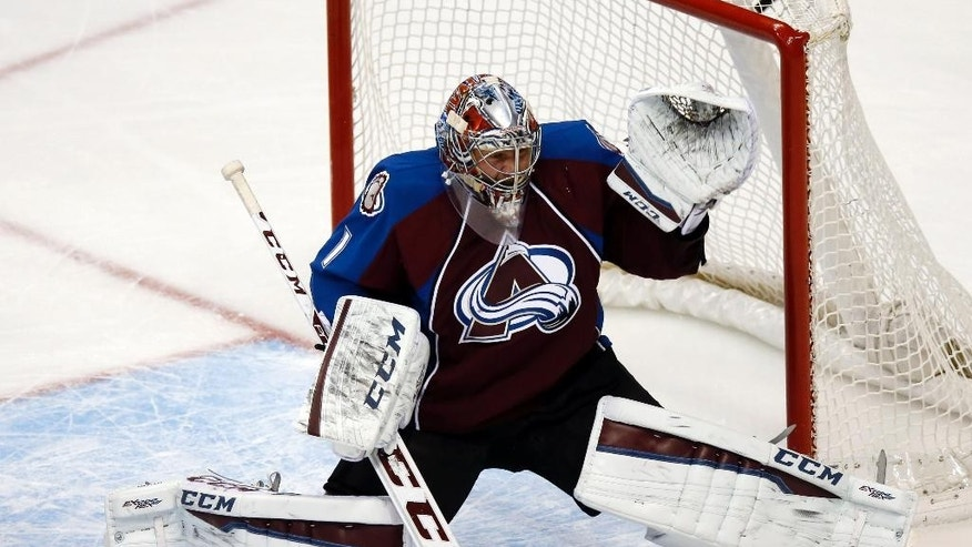 Colorado Avalanche goalie Semyon Varlamov, of Russia, reacts after the puck nestles on top of the net for a goal by Philadelphia Flyers right wing Jakub Voracek in the first period of an NHL hockey game Wednesday, Dec. 31, 2014, in Denver. (AP Photo/David Zalubowski)