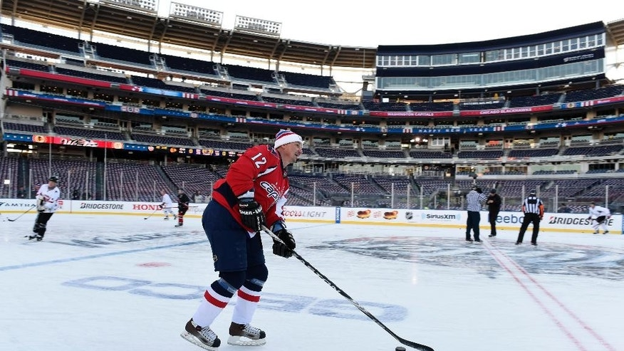 Former Washington Capitals player Peter Bondra skates on the ice before a Washington Capitals alunmi/VIP game at Nationals Park in Washington, Tuesday, Dec. 30, 2014, as part of the events for the Winter Classic outdoor NHL hockey game  to be held on New Year's Day, between the Capitals and the Chicago Blackhawks. (AP Photo/Susan Walsh)