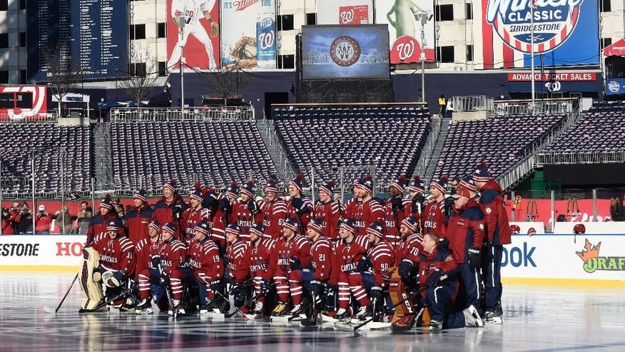 Members of the Washington Capitals pose for a photo at Nationals Park in Washington, Wednesday, Dec. 31, 2014, pose for a photo at Nationals Park in Washington, Wednesday, Dec. 31, 2014, before NHL hockey practice. The Capitals face off against the Chicago Blackhawks in the Winter Classic outdoor hockey game on New Year's Day. (AP Photo/Susan Walsh)