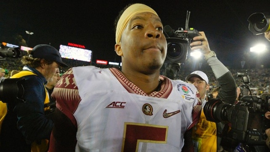 Jan. 1, 2015: Florida State quarterback Jameis Winston walks off the field after Florida State's loss to Oregon during the Rose Bowl NCAA college football playoff semifinal in Pasadena, Calif. (AP Photo/Mark J. Terrill)
