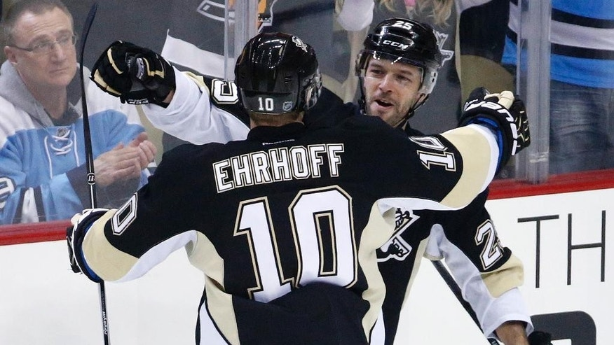 Pittsburgh Penguins' Andrew Ebbett (25) celebrates his goal with Christian Ehrhoff (10) during the first period of an NHL hockey game against the Tampa Bay Lightning in Pittsburgh on Friday, Jan. 2, 2015.(AP Photo/Gene J. Puskar)