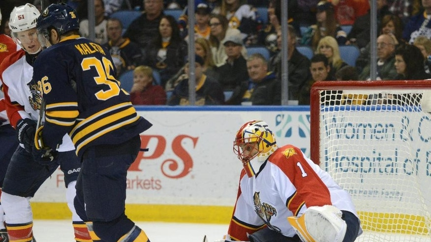 Buffalo Sabres right winger Patrick Kaleta (36) becomes entangled with Florida Panthers defenseman Brian Campbell (51) as Panthers goaltender Roberto Luongo (1) makes the save during the first period of an NHL hockey game Friday, Jan. 2, 2015, in Buffalo, N.Y. (AP Photo/Gary Wiepert)