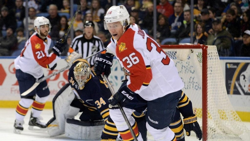 CORRECTS TO JAN. 2, 2015 - Florida Panthers Jussi Jokinen (36), of Finland, gives chase to a loose puck against the Buffalo Sabres during the second period of an NHL hockey game Friday, Jan. 2, 2015, in Buffalo, N.Y. (AP Photo/Gary Wiepert)