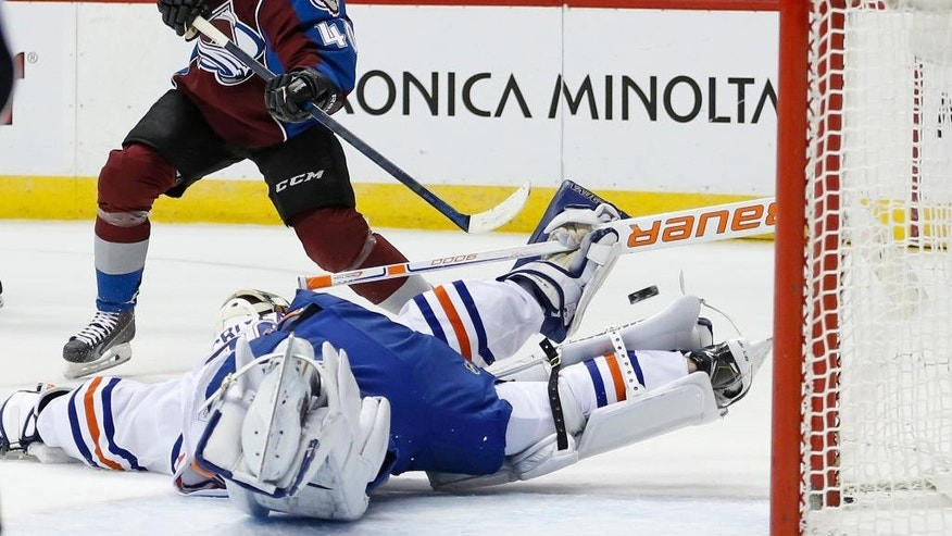 Colorado Avalanche left wing Alex Tanguay (40) scores as shootout goal against Edmonton Oilers goalie Ben Scrivens during an NHL hockey game Friday, Jan. 2, 2015, in Denver. The Avalanche won 2-1. (AP Photo/Jack Dempsey)