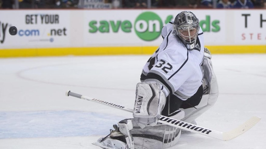 Los Angeles Kings goalie Jonathan Quick stops a Vancouver Canucks shot on goal during the first period of an NHL hockey game in Vancouver, British Columbia, Thursday, Jan. 1, 2015. (AP Photo/The Canadian Press, Darryl Dyck)
