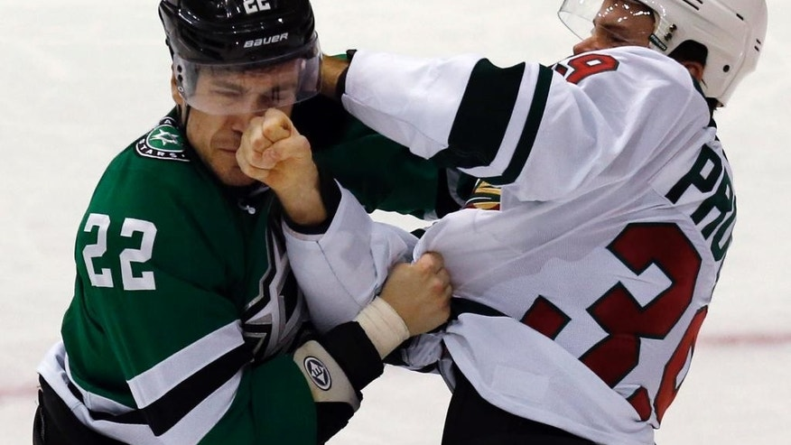 Dallas Stars center Colton Sceviour (22) and Minnesota Wild defenseman Nate Prosser (39) square off during the second period of an NHL hockey game Saturday, Jan. 3, 2015, in Dallas. (AP Photo/John F. Rhodes)