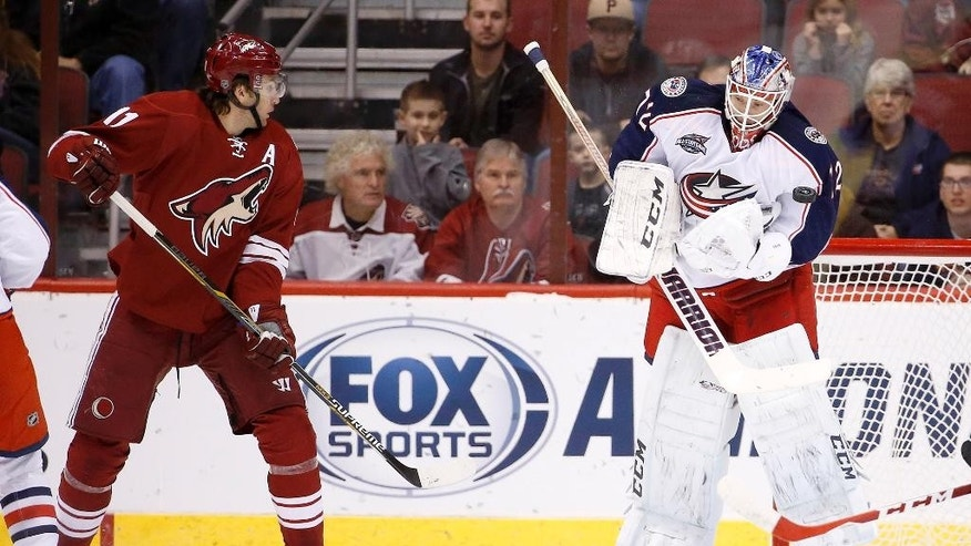 Columbus Blue Jackets' Sergei Bobrovsky (72), of Russia, makes a jumping save on a shot at Arizona Coyotes' Martin Hanzal (11), of the Czech Republic, during the first period of an NHL hockey game Saturday, Jan. 3, 2015, in Glendale, Ariz. (AP Photo/Ross D. Franklin)