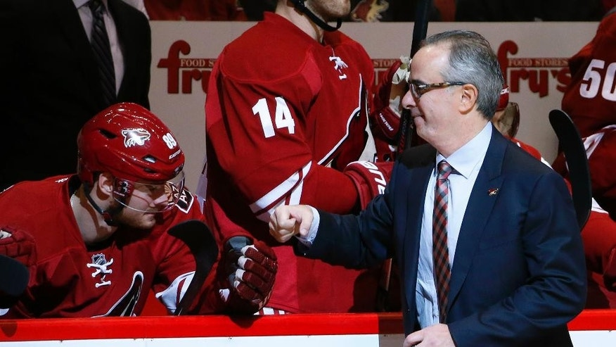 New Arizona Coyotes majority owner Andrew Barroway, right, fist pumps team members, including Mikkel Boedker (89), of Denmark, after Barroway dropped the ceremonial first puck prior to an NHL hockey game against the Columbus Blue Jackets Saturday, Jan. 3, 2015, in Glendale, Ariz. (AP Photo/Ross D. Franklin)