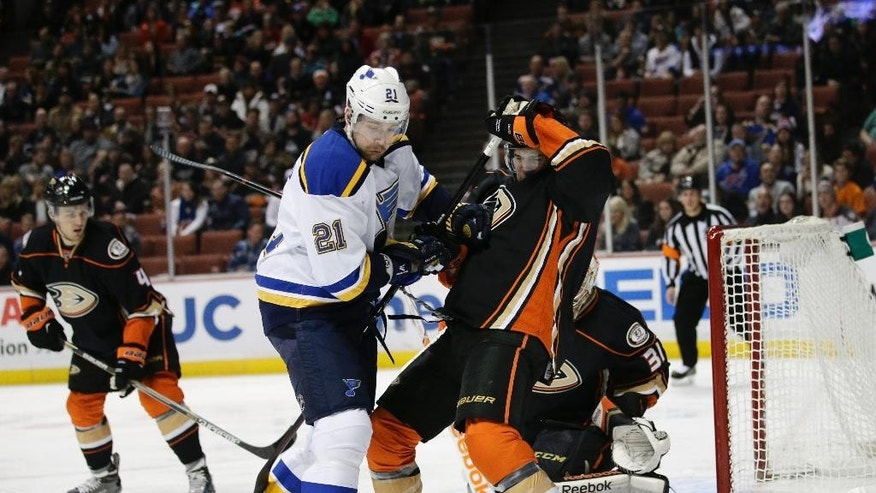 St. Louis Blues' Patrik Berglund, left, of Sweden, and Anaheim Ducks' Ben Lovejoy compete for the puck in front of Ducks goalie Frederik Andersen, of Denmark, during the first period of an NHL hockey game Friday, Jan. 2, 2015, in Anaheim, Calif. (AP Photo/Jae C. Hong)